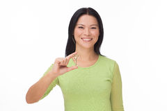 Asian woman hold old key on white Royalty Free Stock Image