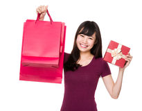 Asian woman hold with paper bag and present box Stock Images