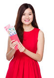 Asian woman hold red pocket money with RMB Stock Photos