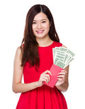 Asian woman hold red pocket with US dollar Royalty Free Stock Photo