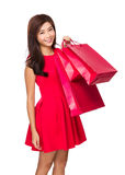 Asian Woman hold with red shopping bag Royalty Free Stock Photography