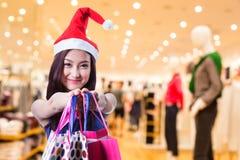 Asian woman hold shipping bag Royalty Free Stock Image