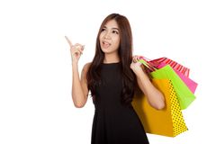 Asian woman hold shopping bags point and look up Royalty Free Stock Photos