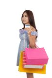 Asian woman hold shopping bags show a credit card look away Royalty Free Stock Photos