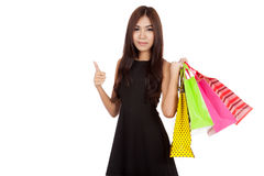 Asian woman hold shopping bags show thumbs up Stock Photography