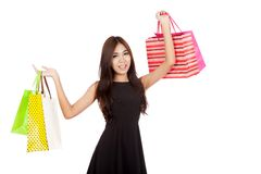 Asian woman hold shopping bags up with both hands Royalty Free Stock Photography