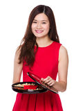 Asian woman hold with snack tray for chinese new year Royalty Free Stock Images