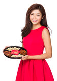 Asian Woman hold with snack tray Royalty Free Stock Photography