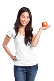 Asian woman holding apple stock images