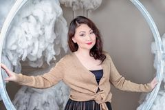 Asian woman holding big round frame Royalty Free Stock Photo