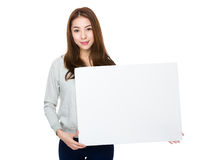 Asian woman holding a blank poster Royalty Free Stock Photography