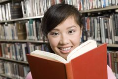 Asian Woman Holding A Book Royalty Free Stock Photo