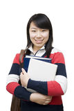 Asian woman holding books Royalty Free Stock Image