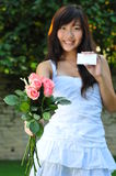 Asian Woman Holding A Bouguet Of Flowers Royalty Free Stock Images