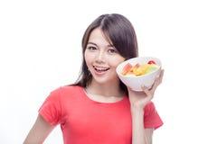 Asian woman holding bowl of fruit Royalty Free Stock Photos