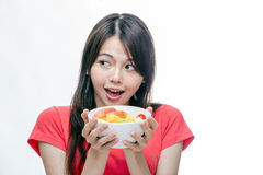 Asian woman holding bowl of fruit Royalty Free Stock Image