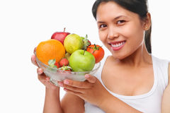 Asian woman holding bowl of fruits Royalty Free Stock Photography