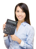 Asian woman holding calculator Stock Photos