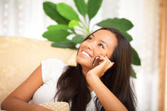 Asian woman holding a cellphone Stock Photos