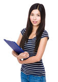 Asian woman holding with clipboard Royalty Free Stock Photos