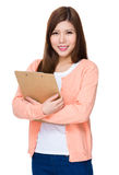 Asian woman holding with clipboard Stock Image