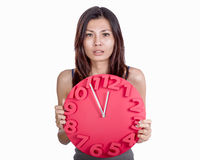 Asian woman holding clock Stock Photo
