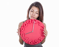Asian woman holding clock Royalty Free Stock Images