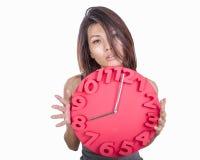 Asian woman holding clock Stock Photos