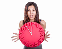 Asian woman holding clock Royalty Free Stock Photo