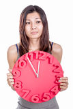 Asian woman holding clock Royalty Free Stock Photography
