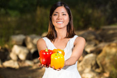 Asian woman holding a colorful bell peppers Royalty Free Stock Photo