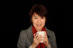 Asian woman holding cup Royalty Free Stock Images