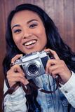 Asian woman holding digital camera Royalty Free Stock Photography