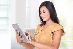 Asian woman holding a digital touch screen tablet computer. A portrait of an asian woman holding a digital touch screen tablet computer stock photos