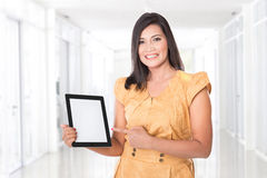 Asian woman holding a digital touch screen tablet computer prese Royalty Free Stock Images