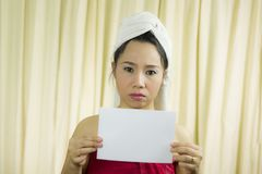 Asian woman holding empty blank banner and acting. she wear a skirt to cover her breast after wash hair, Wrapped in Towels After stock image