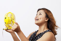 Asian woman holding a fan. Stock Photography