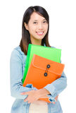 Asian woman holding file pad Royalty Free Stock Photography