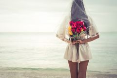 Free Asian Woman Holding Flowers In Behind And Waiting For Someone Ma Royalty Free Stock Photography - 110034727