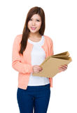 Asian woman holding with folder Royalty Free Stock Images