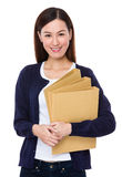 Asian woman holding with folder Royalty Free Stock Photo