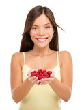 Asian woman holding fresh raspberries in hands royalty free stock photography