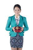 Asian woman holding a gift box Royalty Free Stock Photography