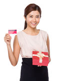 Asian woman holding with gift box and credit card Royalty Free Stock Image