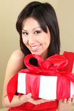 Asian Woman Holding a Gift Package Royalty Free Stock Photography
