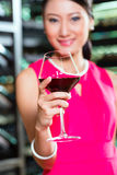 Asian woman holding glass of wine. Portrait of young Asian woman with glass of red wine Stock Photos
