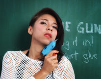 Asian woman holding a glue gun stock photos