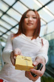 Asian woman holding gold gift box Stock Photography