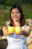 Asian woman holding green apples Royalty Free Stock Photos