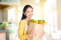 Asian woman holding groceries bag in market Royalty Free Stock Photography
